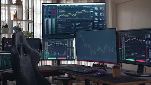 Stock Market Trader Multiple Computer Monitors With Financial Charts