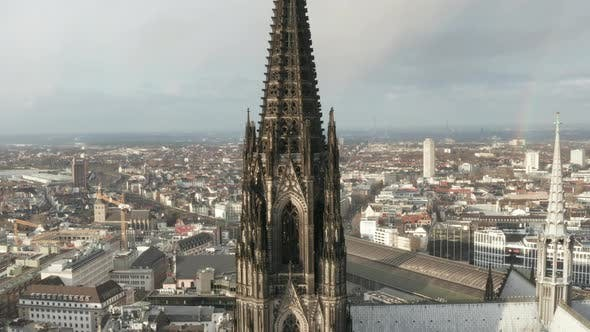 AERIAL: Close Up of Cologne Cathedral Two Brown Towers in Beautiful Sunlight