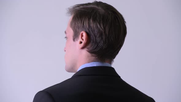 Thumbnail for Rear View of Young Handsome Businessman Looking Back