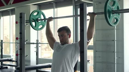 Strong Man Lifting Heavy Barbell at Gym, Training Back Muscles, Slow Motion