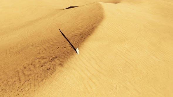 Arab Male Walk on Dunes