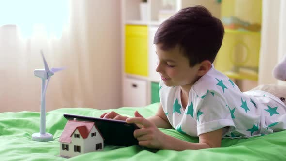 Thumbnail for Boy with Tablet Pc and Wind Turbine Toy at Home