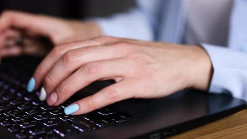 Unrecognizable Businesswoman female hands using typing on laptop notebook keyboard
