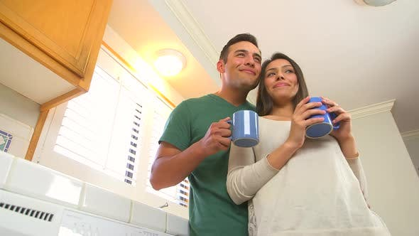 Hispanic couple drinking coffee