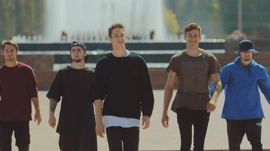 Group of Young Guys Walking in the Park