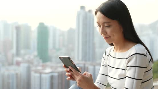 Thumbnail for Woman Use of Mobile Phone in City