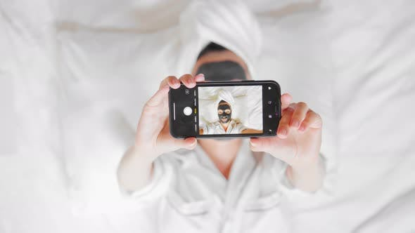 Thumbnail for Female Portrait Holding Mobile Beauty Routine in Apartment