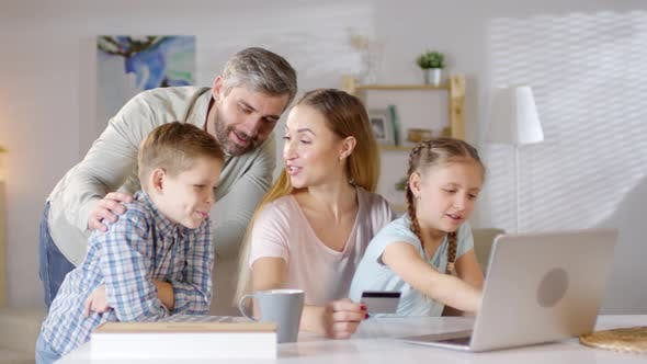 Thumbnail for Cheerful Family Buying Goods Online