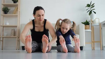 Little Girl with Mother Doing Fitness Exercises