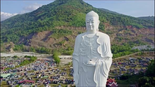 Thumbnail for Closeup Flycam Shoots Buddha Statue Against Landscape