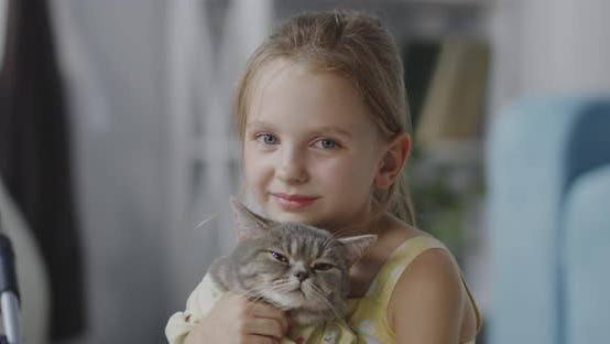 Thumbnail for Girl Holding a Cat