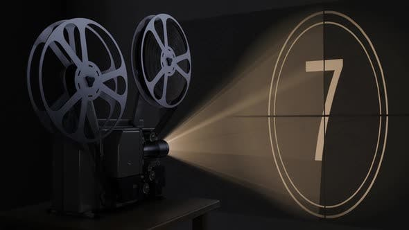 Movie Projector with Film Reel Plays the Retro Countdown Video on the Screen