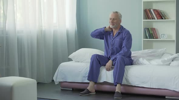 Thumbnail for Waking up full of energy and optimism cheerful old man doing morning gymnastics
