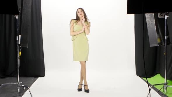 Thumbnail for Model Posing in Photo Studio. White