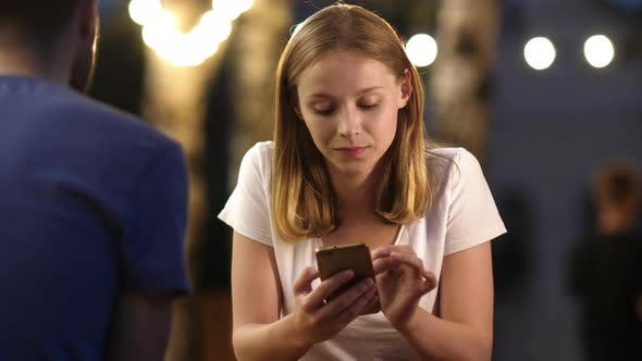 Thumbnail for Cute Girl Using a Phone While Her Boyfriend Is Talking To Her