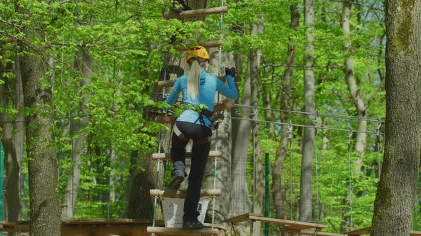 Thumbnail for Climbing up the ladder in an adventure park
