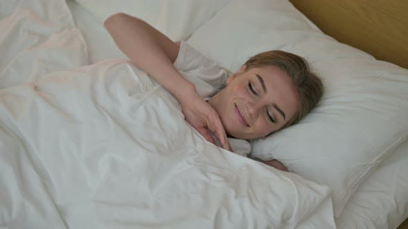 Thumbnail for Attractive Young Woman Waking Up and Getting Out of Bed