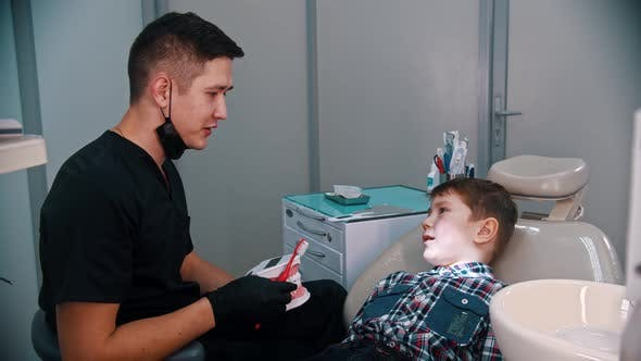 Thumbnail for A Little Boy Having a Treatment in the Modern Dentistry - Talking About the Hygiene