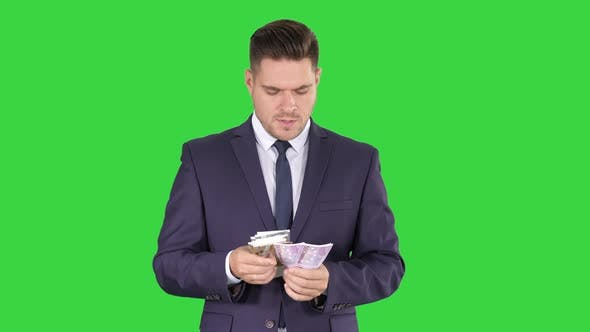 Thumbnail for Handsome Businessman Counting Euros on a Green Screen, Chroma Key