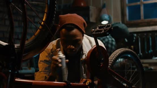 Cover Image for Man Working in a Bicycle Repair Shop