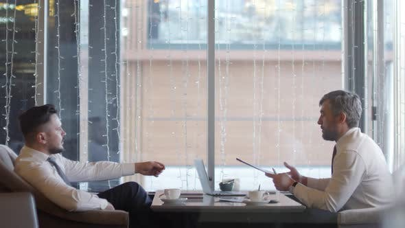 Thumbnail for Two Businessmen on Business Meeting in Restaurant