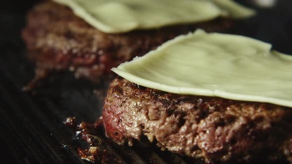 Thumbnail for Beefsteak With Cheese Fries On A Grill