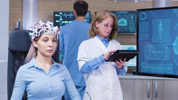 Thumbnail for Female Patient with Eyes Closed Wearing Headset with Brain Sensors