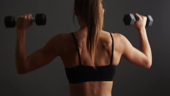 Thumbnail for Fit healthy woman lifting weights