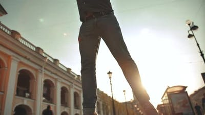 Attractive Handsome Man Jumping in Urban Street.