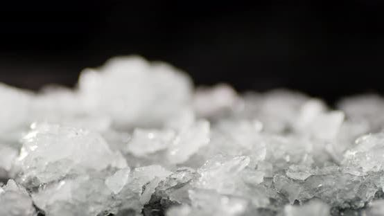 Pieces of Ice Fall on the Table. On a Black Background