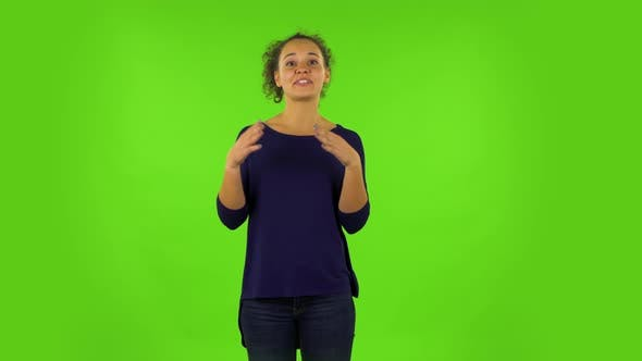 Thumbnail for Curly Woman Talking About Something Then Making a Hush Gesture, Secret. Green Screen