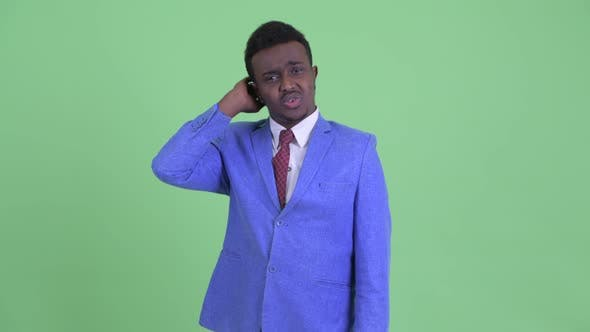 Cover Image for Confused Young African Businessman Scratching Head