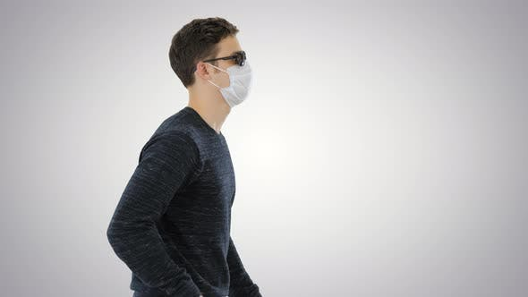Thumbnail for Young Blind Person with Long Cane and Medical Mask Walking on Gradient Background.