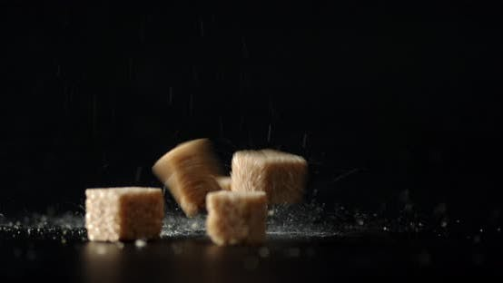 Brown Sugar Cubes Fall on the Table