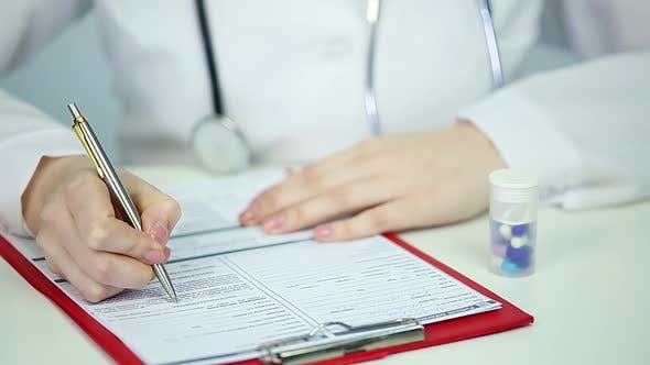 Thumbnail for Doctor Filling in Patient's Registration Form, Medical Receptionist at Hospital