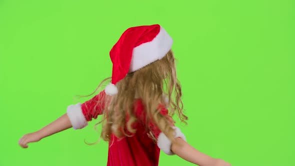 Baby Is Spinning in Her New Year's Costume. Green Screen