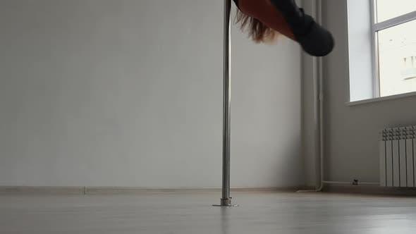 Thumbnail for Flexible Woman Dancing on Pole in Studio