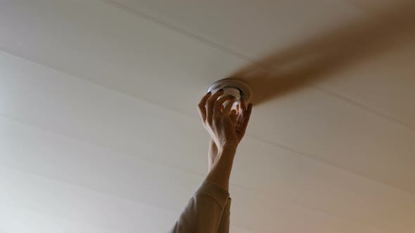 Thumbnail for Woman Set the Light Bulb in the Ceiling and Turning on a Light