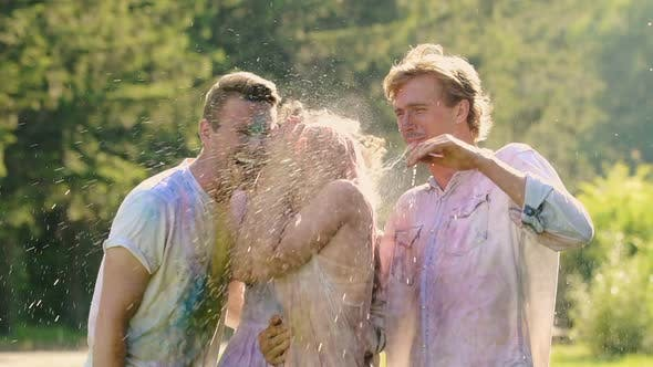 Cover Image for Two Loving Couples Getting Splashed With Water After Colorful Powder Paint Fight