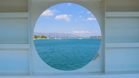 Thumbnail for City Summer Landscape View of Greece Seen From Inside a Ship Cabin with Round Peep-hole Window