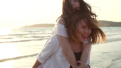 LGBT friends playing on beach, beautiful women friends feel happy and fun relax playing on beach.