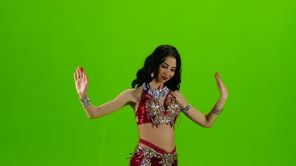 Thumbnail for Dancing Belly Dance with Red Dress. Green Screen. Slow Motion