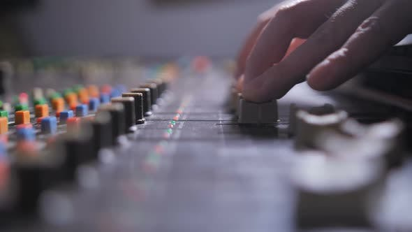 Thumbnail for Hand of Record Producer Working on Mixing Console