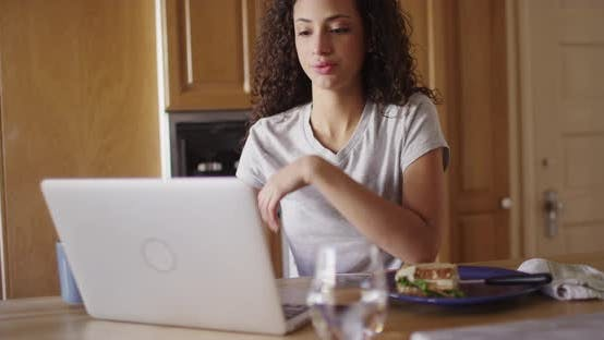 Thumbnail for An attractive young latino woman typing on a laptop computer