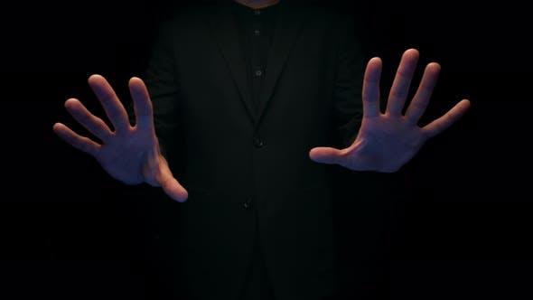 Man Posing over Black Background
