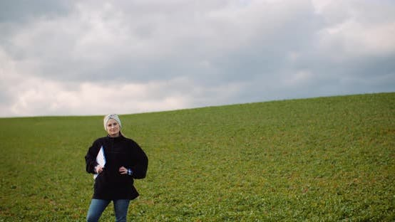 Thumbnail for Female Farmer Examining Oilseed Rape Field