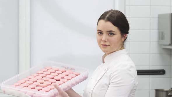 Thumbnail for Professional Pastry Chef Smiling Holding a Tray Full of Delicious Macaroons