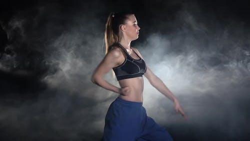 Women Shows Sophisticated Karate Techniques. Black
