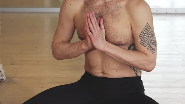 Thumbnail for Handsome Young Man Meditating in Yoga Position