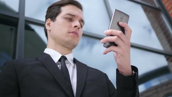 Thumbnail for Businessman in Suit Using Smartphone, Outdoor